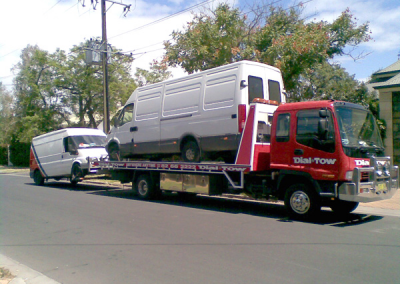 Two vans being towed locally