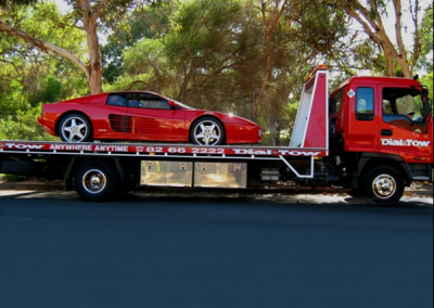 Towing a prestige car ferrari in one of our tow trucks