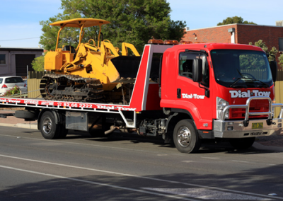 Front loader being towed