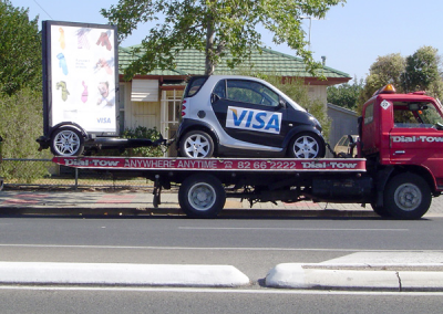Car and trailer signage being towed simultaneously