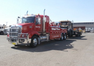 Heavy Truck Towing with one of our fleet's 12 ton heavy tilt tow trucks