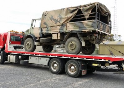 Dial-a-Tow assisting Australian army with towing of army truck using a tilt truck from its fleet